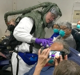 US flies 338 Americans home, including 14 with coronavirus