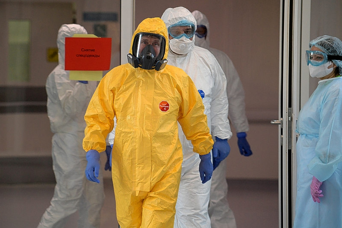 Putin dons hazmat suit as Moscow says coronavirus outbreak is worse than it looks
