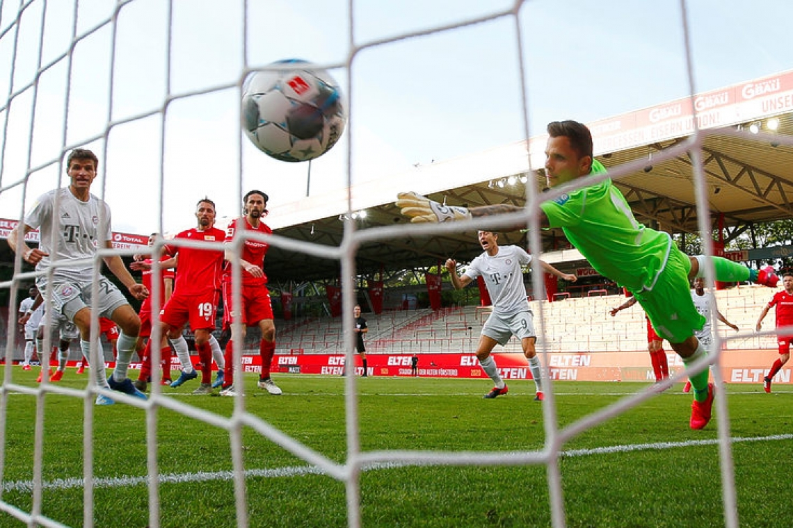 Bayern ease past Union 2-0 in league restart to stay top