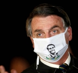 Bolsonaro catches coronavirus, shrugs off health risks
