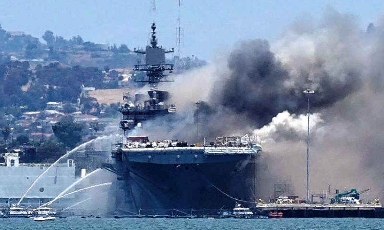 Fire aboard US Navy warship in San Diego injures 21 people